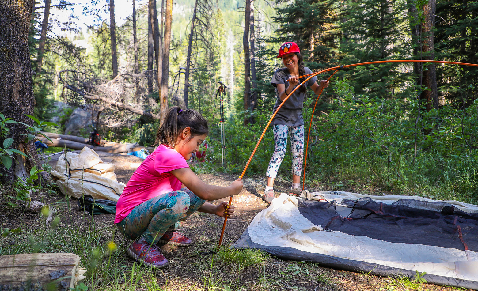 Joselin and Michelle set their backpacking tent up after a long day hiking the Cross Creek Trail. The kids were given instruction on how to put up the tent, but most of it was figured out on their own.